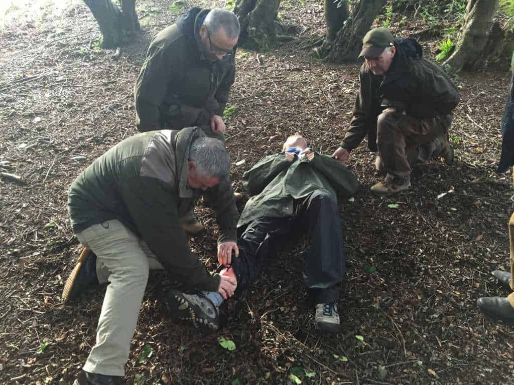 stalkers training during a first aid with forestry scenario with one man on the ground