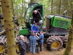 removing casualty from a forestry machine during first aid with forestry training in Scotland